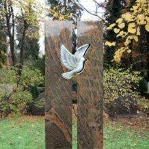 Grabstein aus Granit mit weißer Taube